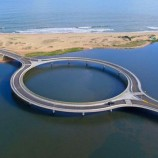 Can you guess why architects built this road bridge circular instead of straight?